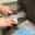 sharpening a kitchen knife on a grindstone